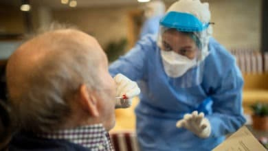 In this photo taken on Wednesday April 1, 2020, aid workers carry out coronavirus detection tests on the elderly at a nursing home.| AP
