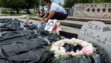 Photo of Symbolic corpses displayed to honor COVID-19 victims, protest unemployment