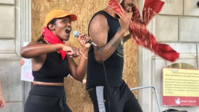 Photo of Black Lives Matter protester sings for justice