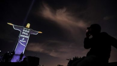 Photo of Christ the Redeemer pays homage to coronavirus victims