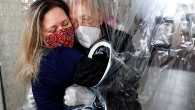 Photo of Plastic curtain allows relatives to hug quarantined elderly in Sao Paulo