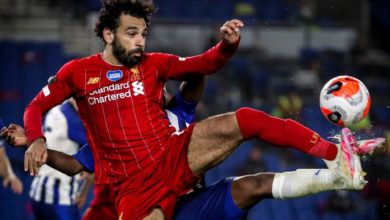 Photo of Liverpool beat Brighton 3-1 to stay on record pace