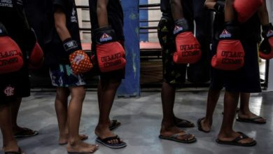 Photo of Rio favela residents staying out of trouble thanks to boxing, martial arts