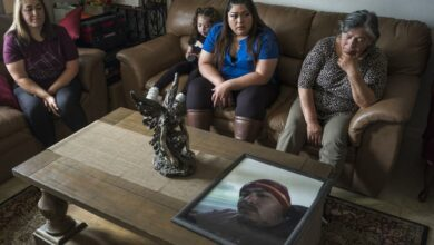 Family members of Jerry Ramos become emotional when looking at a photo of him at the family home in Watsonville, Calif., Sunday, June 6, 2021. He died Feb. 15 at age 32, becoming not just one of the roughly 600,000 Americans who have now perished in the outbreak but another example of the virus's strikingly uneven and ever-shifting toll on the nation's racial and ethnic groups. (AP Photo/Nic Coury)