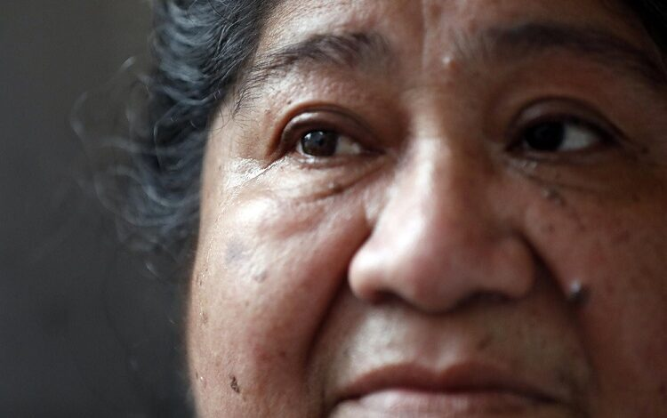 María Elena Estamilla, 62, sheds a tear while sharing her struggle of remaining without insurance. (AP Photo/Shafkat Anowar)